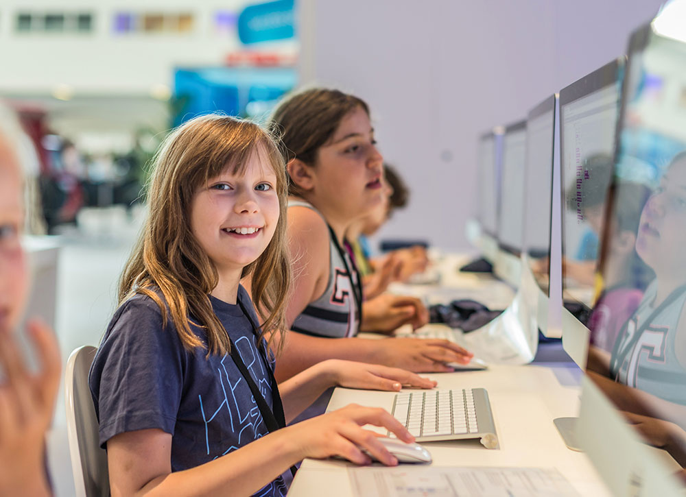 Girls participating in a coding workshop