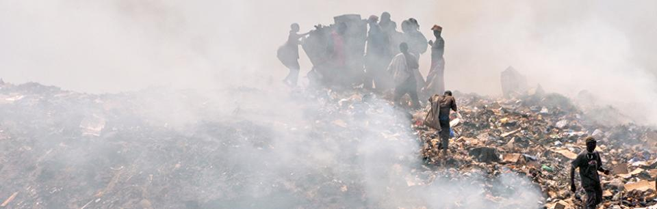 People collect waste in a dump, Bamako, Mali
