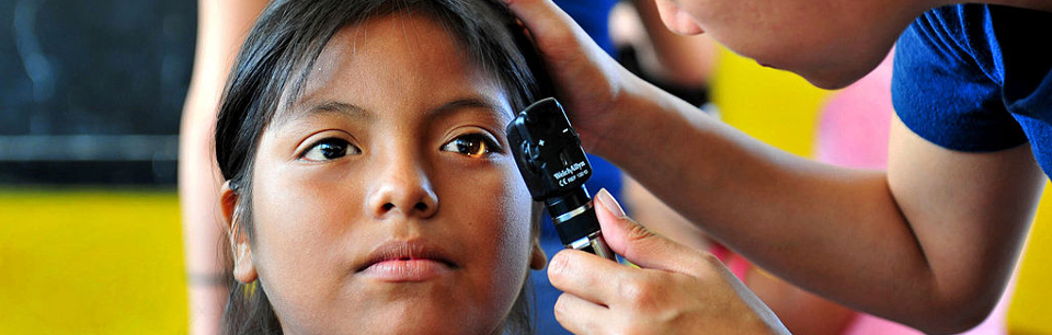 Doctor examines a patient's eyes in Paita, Peru