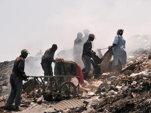 People throw waste on a dump, Bamako, Mali