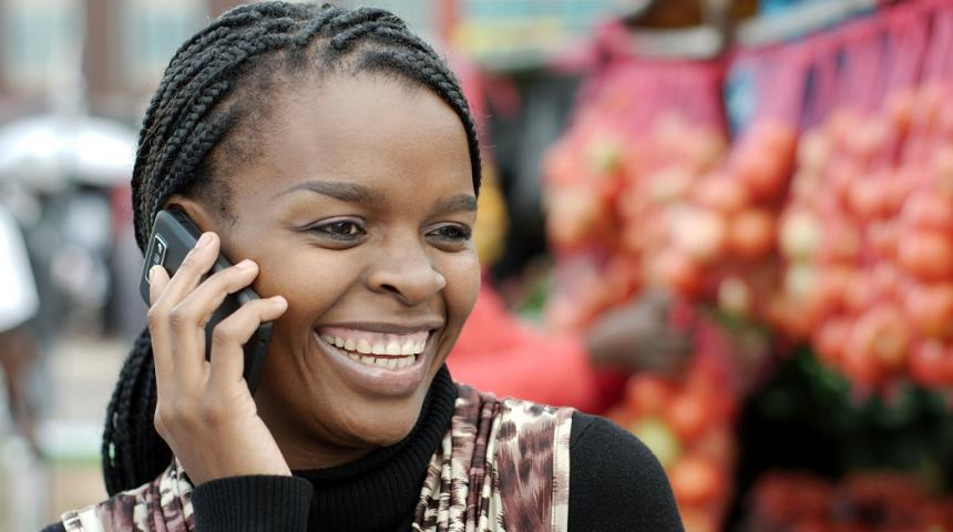 African or black American woman calling on mobile cellphone telephone