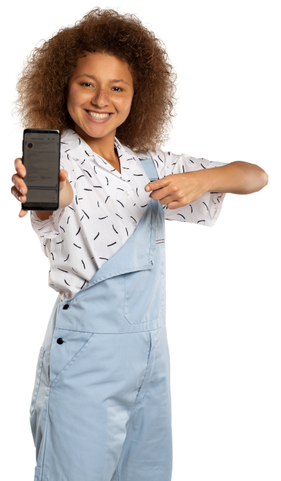 Young woman smiling and showing her mobile phone