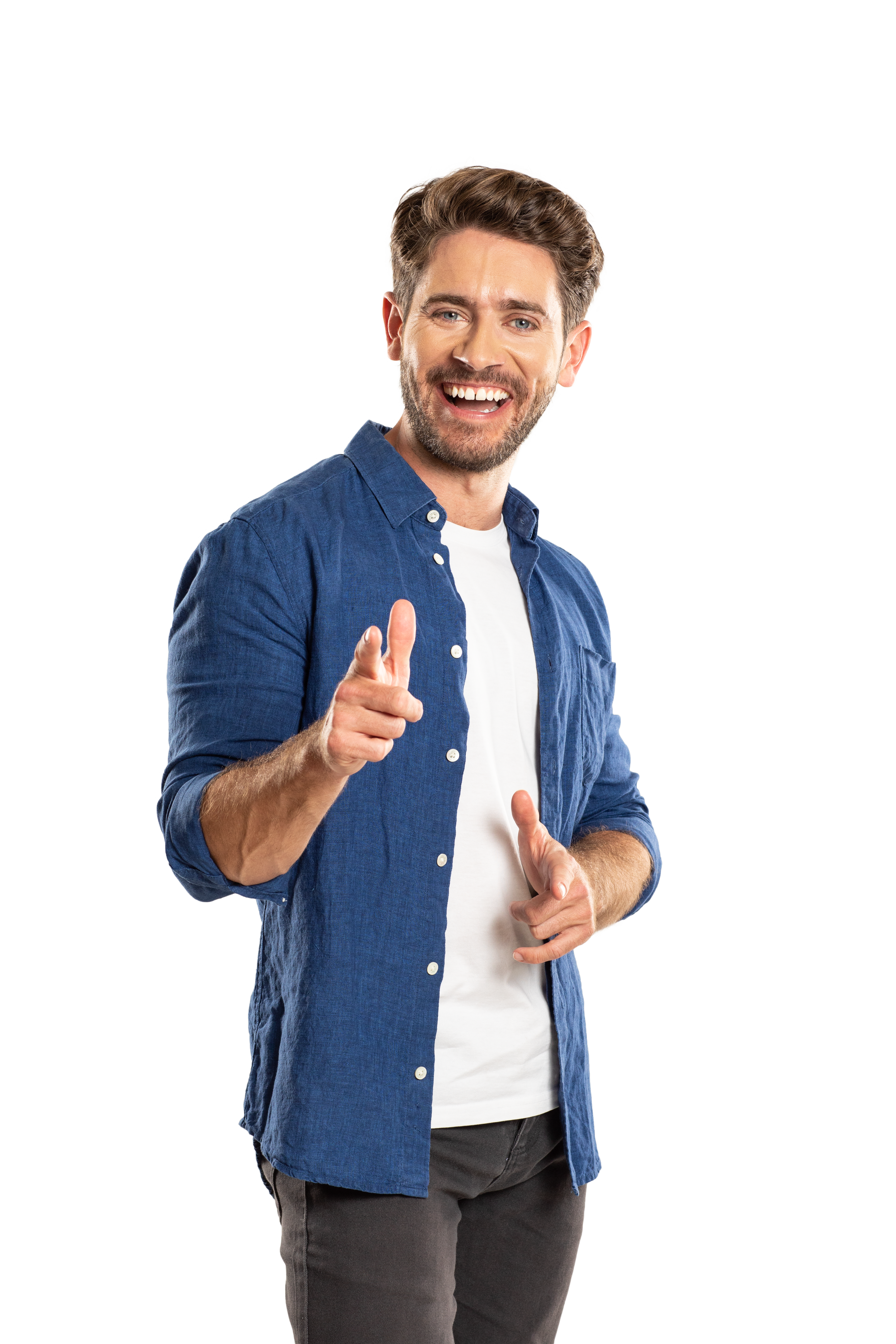 A smiling man standing pointing his finger as if to say do you have your Europass?