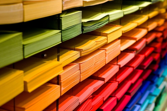 Multi-coloured folders piled up