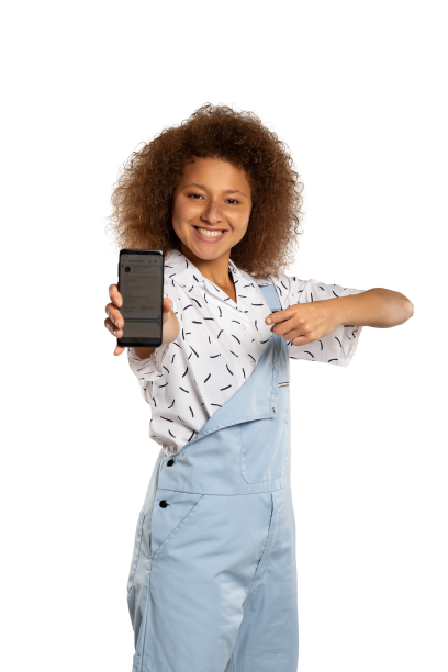 Smiling young woman showing her mobile phone