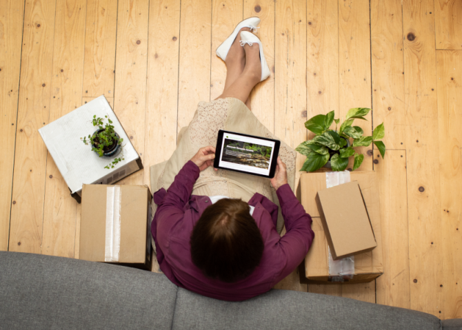 top angle photo of woman stillon the floor working on her laptop