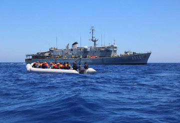 a boat with refugees in the sea © EU