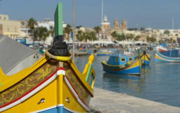 Typical Maltese boats in a port © EU