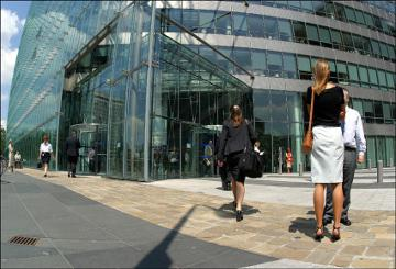 Charlemagne building and people walking in front of it © EU