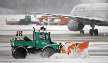 A snowplow on the tarmac of an airport © EU