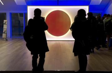 People looking at a representation of the Japanese flag at an expo © EU