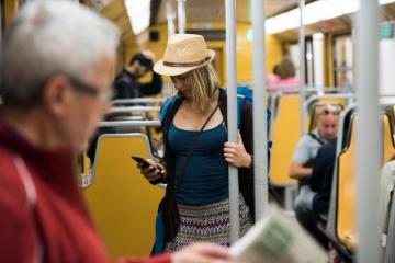 A young woman using her smartphone on the metro © EU