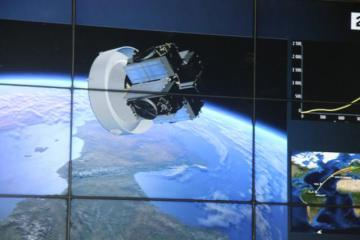 View of screens showing space, a satellite, graphs © EU
