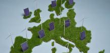 Windmills and solar panels on green map of Europe © EU