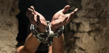 Man with hands chained © EU