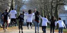 8 young people wearing the European Solidarity Corps t-shirt © EU