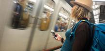 Woman using mobile phone in Brussels metro © EU