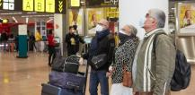 Passengers wearing face masks at Brussels airport © EU