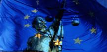 Statue of Lady Justice with EU flag in background © EU
