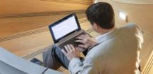 Man working with a laptop computer © EU