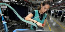 Young woman working in textile factory © EU
