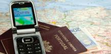Mobile phone on passports, euro notes and map © EU