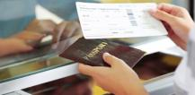 Passenger holding airplane ticket and passport © EU