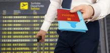 Man at an airport holding a passport and travel documents © EU