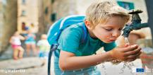 Young boy drinking water from tap © EU
