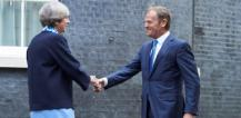 Theresa May and Donald Tusk shaking hands © EU