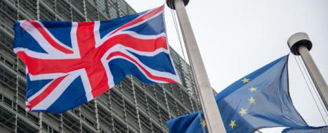 British and European flags in front of Berlaymont building © EU
