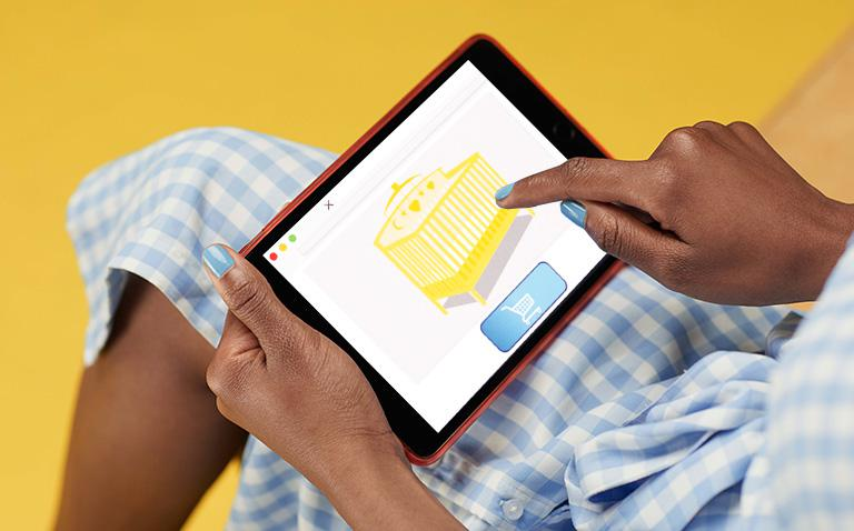 close-up image of lady ordering a crib on an iPad
