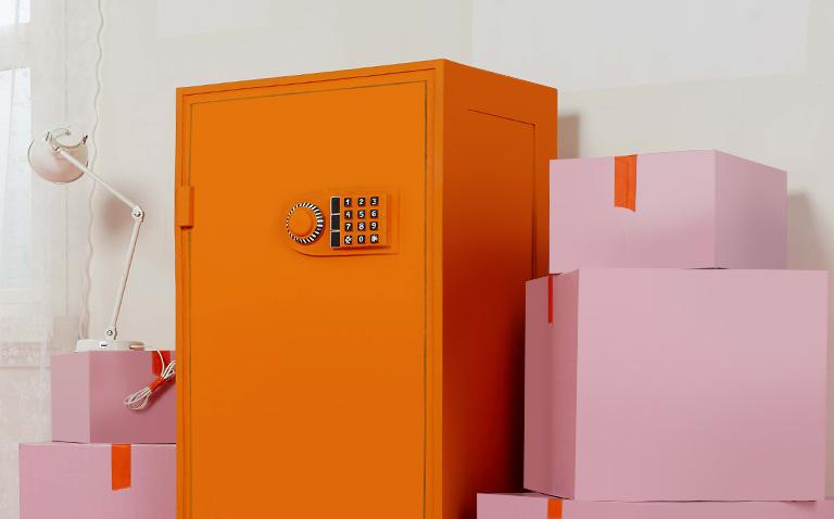 image of orange bank safe with pink housemoving boxes
