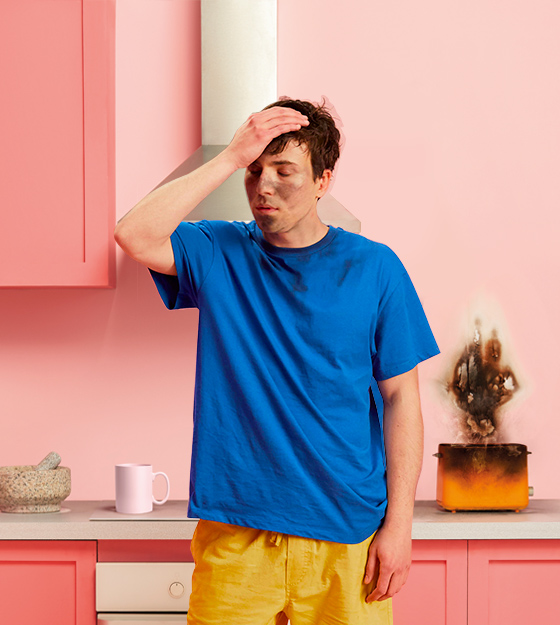 image with man holding forehead after toaster exploded
