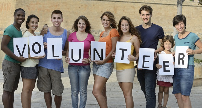 Group of young people, volunteer sign