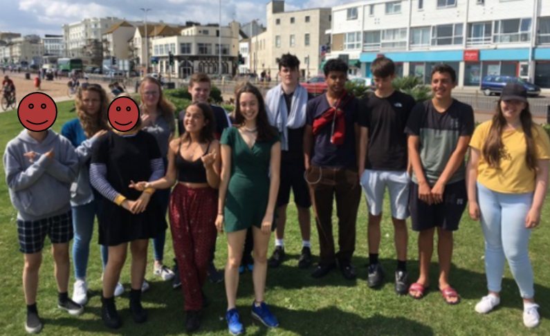 a group of young people volunteering outdoors