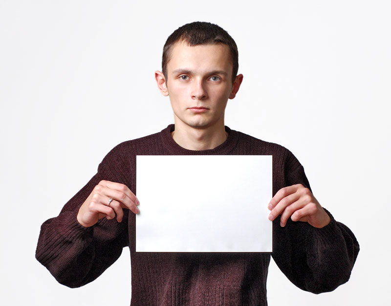 Young man holding a blank paper. Source: Colourbox.com
