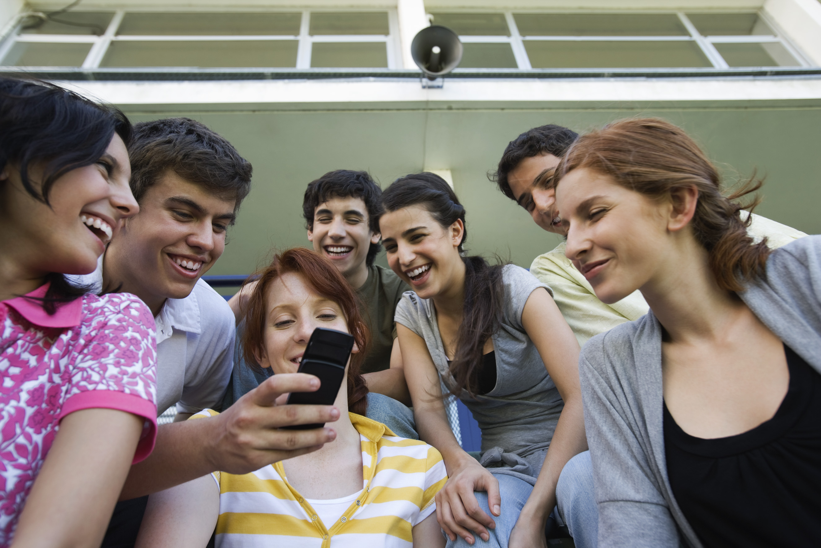 Young people looking at a mobile phone. Source:colourbox.com
