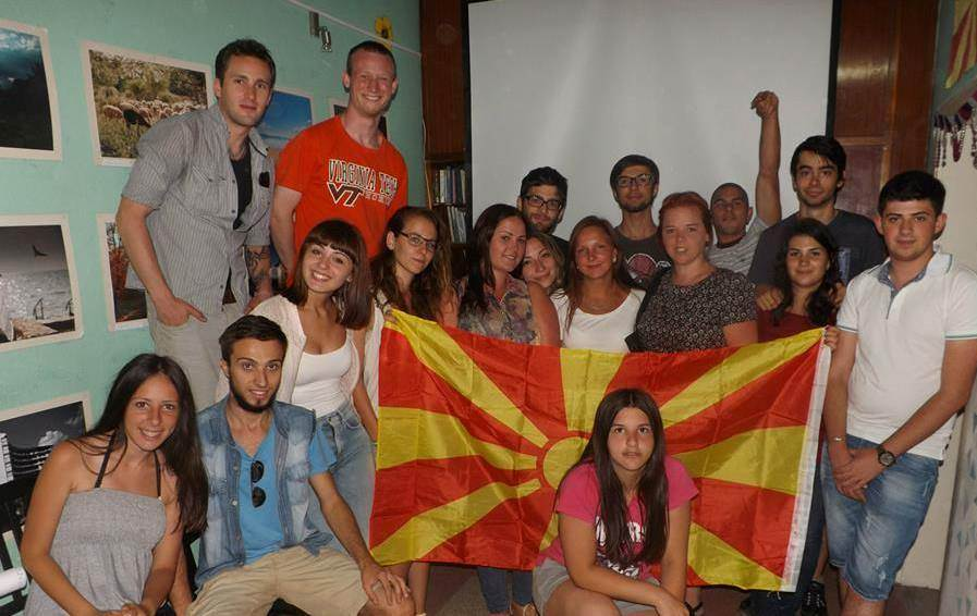 Group of EVS volunteers with Macedonian flag