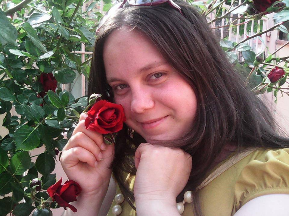 Delia holding a rose