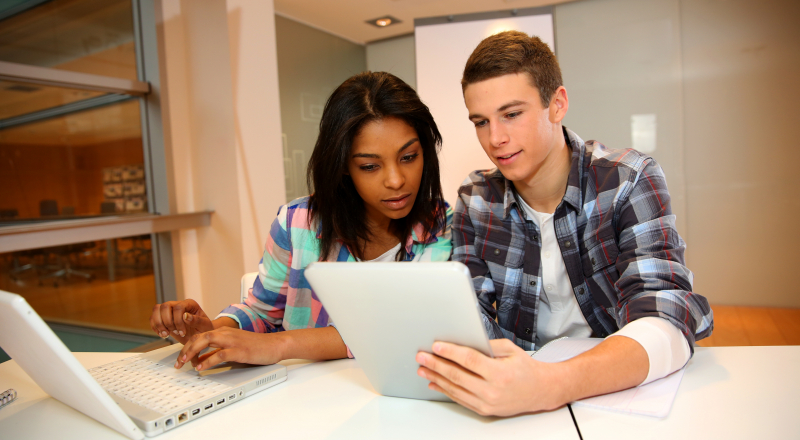 Female and male students learning together