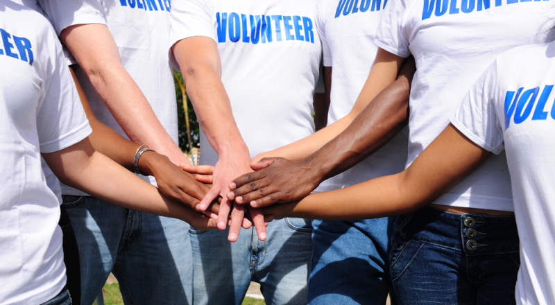 A picture of volunteers shaking hands