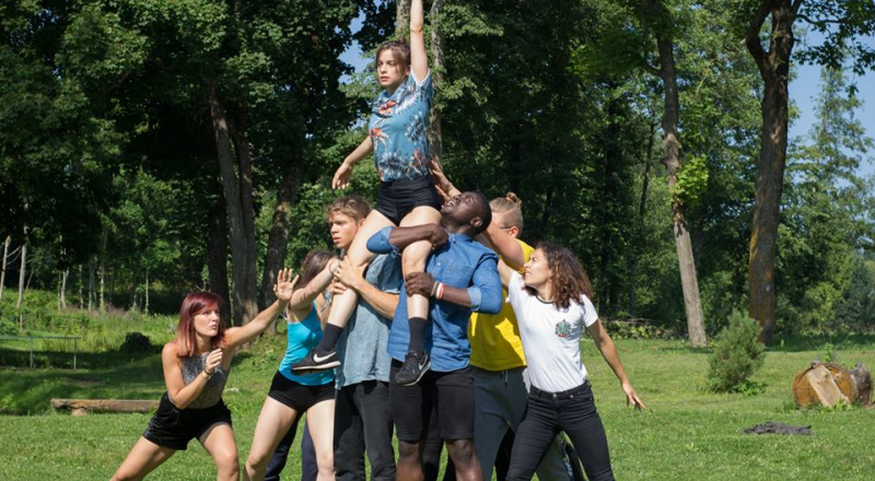 Young people building a human pyramid