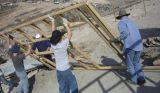 People working on a building site together